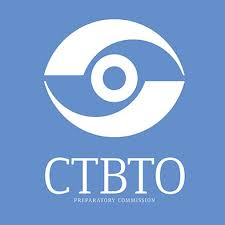 CTBTO Logo with a white eye on blue background.